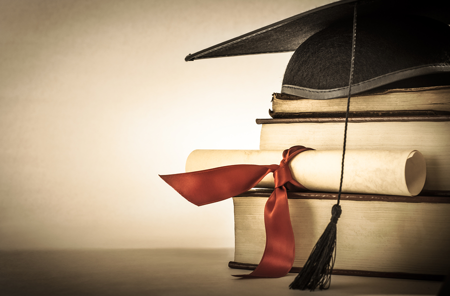 bigstock-Graduation-Scroll-And-Book-Sta-51249898