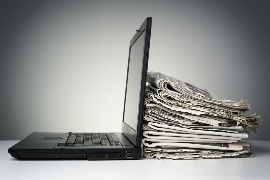 bigstock-Laptop-and-newspaper-concept-f-66698950