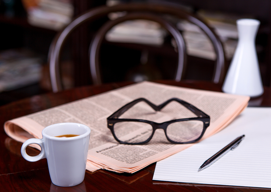 bigstock-Cup-Of-Coffee-And-Newspaper-72434437