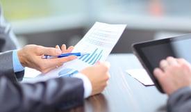 bigstock-Business-team-analyzing-market-39980689